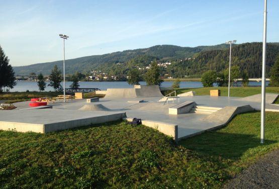 Concrete skatepark next to lake in Norway