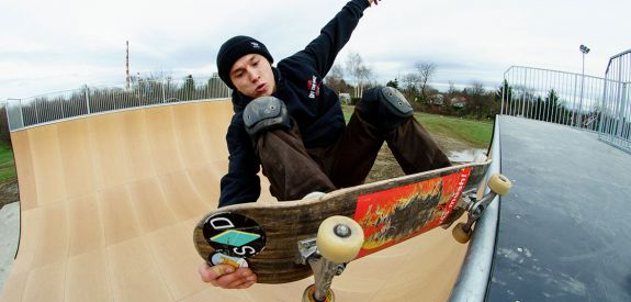 Skateboard on Vert Ramp